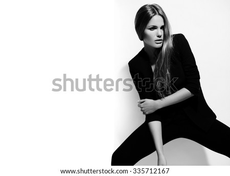 High fashion look.glamor beautiful sexy hot stylish Caucasian young brunette woman model in black hipster clothes posing near white wall