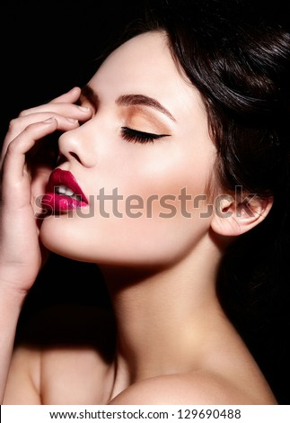 High fashion look.glamor closeup portrait of beautiful sexy brunette Caucasian young woman model with bright makeup, with red lips,  with perfect clean  skin - stock photo
