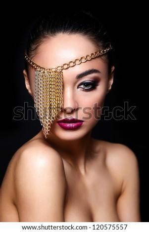 High fashion look.glamor closeup portrait of beautiful sexy Caucasian young woman model with colorful lips,bright makeup, with perfect clean skin with jewelery on eye isolated on black