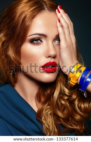 High fashion look.glamor closeup portrait of beautiful sexy stylish blond Caucasian young woman model with bright makeup, with red lips,  with perfect clean skin with colorful accessories - stock photo