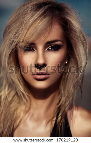 High fashion look.glamor closeup portrait of beautiful sexy stylish blond Caucasian young woman model with bright makeup, with perfect sunbathed clean skin with black eye outdoors - stock photo