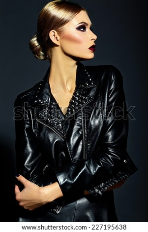 High fashion look.glamor closeup portrait of beautiful sexy stylish blond  young woman model with bright makeup with red lips with perfect clean skin in black cloth - stock photo
