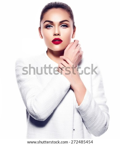 High fashion look.glamor closeup portrait of beautiful sexy stylish brunette business young woman model with bright makeup with red lips in white coat jacket - stock photo