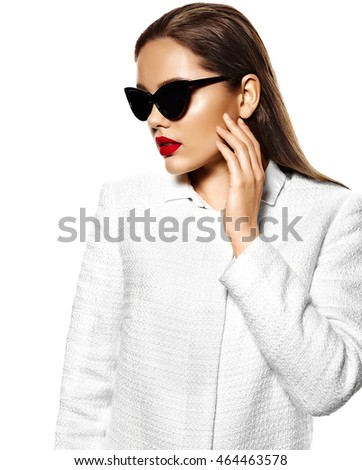 High fashion look.glamor closeup portrait of beautiful sexy stylish brunette business young woman model with bright makeup with red lips in white coat jacket isolated on white