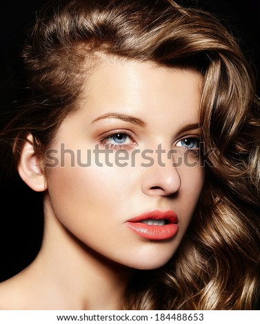 High fashion look.glamor closeup portrait of beautiful sexy stylish brunette Caucasian young woman model with bright makeup, with curly healty hair with blue eyes big lips in studio