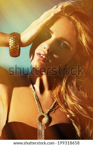High fashion look.glamor closeup portrait of beautiful sexy stylish brunette Caucasian young woman model with bright makeup, with perfect sunbathed clean skin with jewelery outdoors in vogue style - stock photo