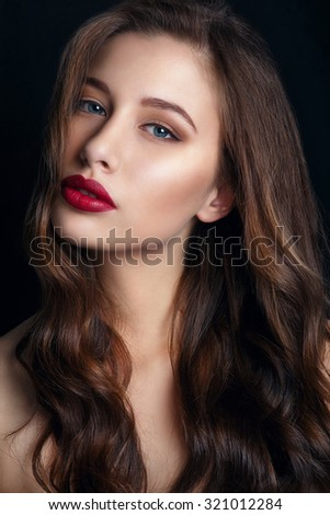 High fashion look.glamor closeup portrait of beautiful sexy stylish brunette young woman model with bright makeup with red lips.Beautiful girl with red lips on black Background. Gorgeous Woman Face. - stock photo