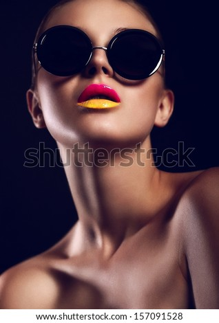 High fashion look.glamor closeup portrait of beautiful sexy stylish mode in sun glasses with bright colorful lips  with perfect clean skin in studio - stock photo