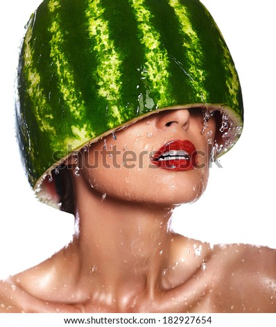 High fashion look.glamor closeup portrait of beautiful sexy young woman model with water-melon on head with water drops with red lips, with perfect wet clean skin