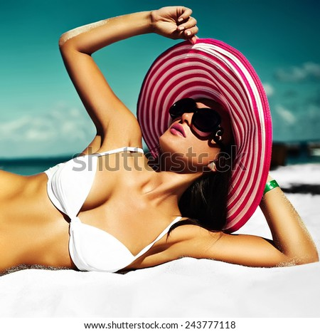 High fashion look.glamor sexy sunbathed model girl in white lingerie bikini in colorful sunhat behind blue beach ocean water in vogue style - stock photo