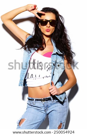 High fashion look.glamor stylish beautiful  young woman model  in summer bright colorful casual jeans  hipster cloth - stock photo