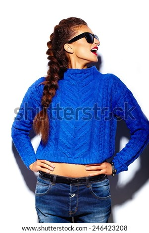 High fashion look.glamor stylish beautiful  young woman model with red lips  in blue sweater hipster cloth in sunglasses - stock photo