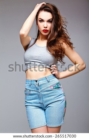 High fashion look.glamor stylish sexy beautiful young woman model in summer bright jeans shorts hipster cloth  - stock photo