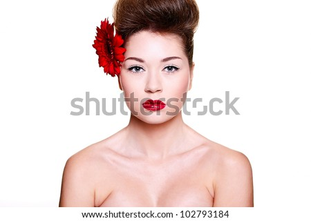 High fashion look.glamour close-up portrait of sexy brunette caucasian young female woman with bright make-up with red lips and red bright manicure with red big flower in hair