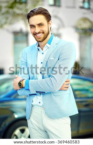 High fashion look.Young stylish confident happy handsome smiling businessman model man in blue suit cloth lifestyle in the street