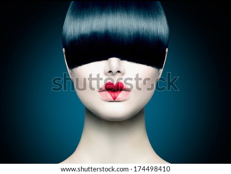 High Fashion Model Girl Portrait with Trendy Fringe Hair style and Red Heart lips Makeup. Long Black Fringe Hairstyle, Black Hair and Red Matte Lipstick. Woman Makeup. Sexy Lips. Haircut  - stock photo