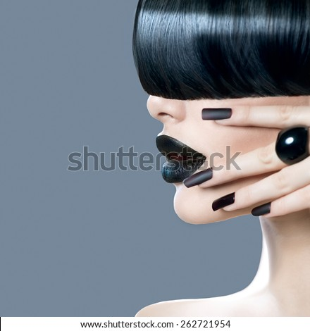 High Fashion Model Girl Portrait with Trendy Hair style, Black Make up and Manicure. Woman profile face. Long Black Glossy Fringe Hairstyle, Black Matte Nail Polish and Lipstick. Makeup. Haircut