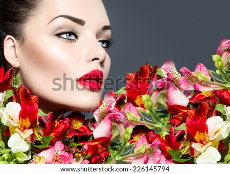 High fashion model girl with colorful flowers and red lips. Vogue style woman portrait. Beautiful face makeup. Glamorous lady. Vivid colours - stock photo