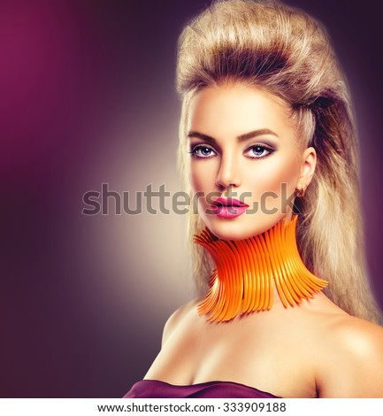 High Fashion Model Girl with Mohawk hairstyle and vivid make up. Beauty woman with glamour updo hair style - stock photo