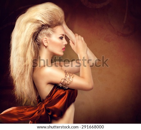 High Fashion Model Girl with Mohawk hairstyle. Beauty woman with glamour updo hair style. Blonde Slim Lady - stock photo
