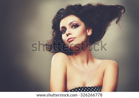 High Fashion Model Girl with Updo hairstyle. Beauty woman with glamour hairdo hair style. Beauty Brunette Lady portrait - stock photo