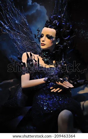 High fashion model in blue dress at a fantasy party illustration - stock photo