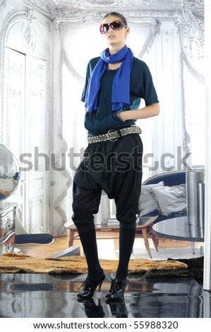 High fashion model in modern dress posing - stock photo