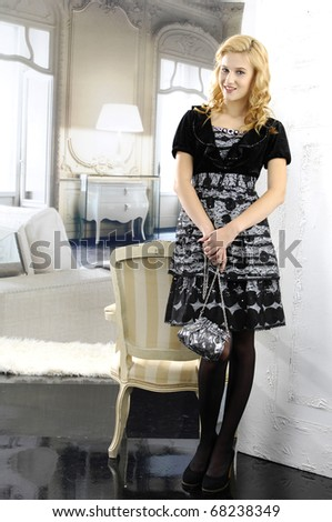 High fashion model in modern dress posing in the studio