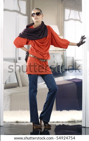 High fashion model in red dress posing - stock photo