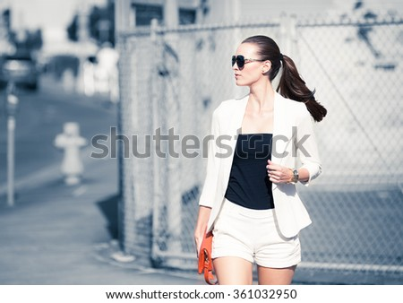 High fashion model walking down the street.  - stock photo