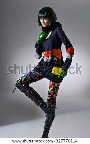 High fashion model wearing  gloves posing in studio - stock photo