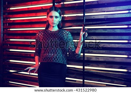 high fashion portrait of young elegant woman posing in studio - stock photo
