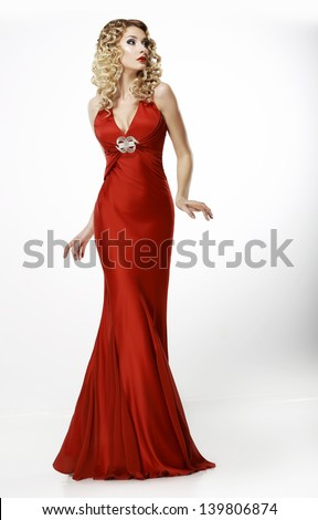 High Fashion. Shapely Blonde in Silk Evening Red Gown. Femininity - stock photo