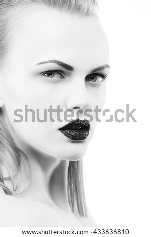 High fashion vogue style, cosmetics and make-up. Studio portrait of female caucasian young blonde model with black lipstick. Isolated on white background. Studio portrait. Black and white