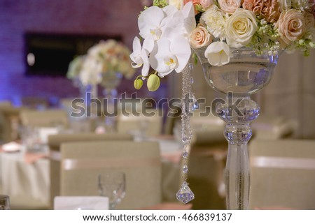 High glass vase decorated with crystals