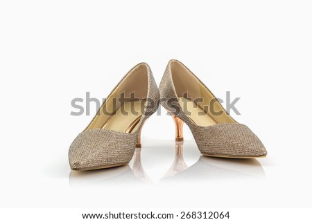 High heel of golden shoes on white background.  - stock photo