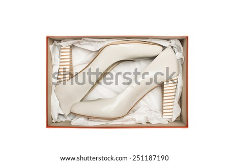 high heel shoes in box isolated on white background - stock photo