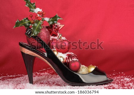 High heel shoes with Christmas decorations - stock photo