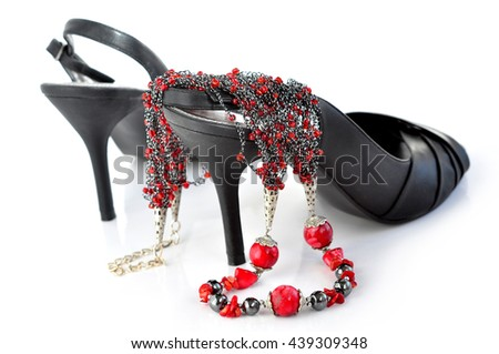 High heels and a red necklace  - stock photo