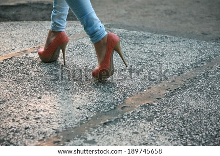 High heels and tight jeans - stock photo