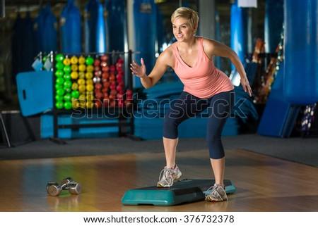 High intensity level cardio fat and calorie burn aerobic class crossfit fun cute beauty - stock photo