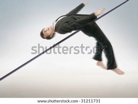 High jumping businessman - stock photo