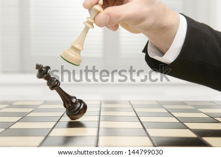 High key image of a Chess board. Checkmate by the black Pawn. - stock photo