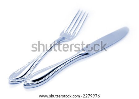 High key photo of blue toned fork and knife
