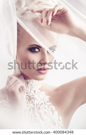 High key portrait of a delicate blonde beauty - stock photo