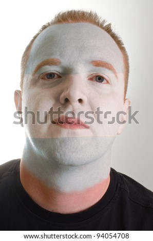 High key portrait of a serious man whose face is painted in national colors of argentina