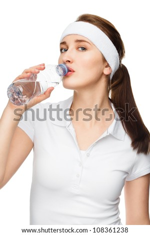 High key Portrait of attractive young woman drinking water isolated on white background