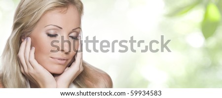 High key portrait of young beautiful  woman in tropic environment - stock photo