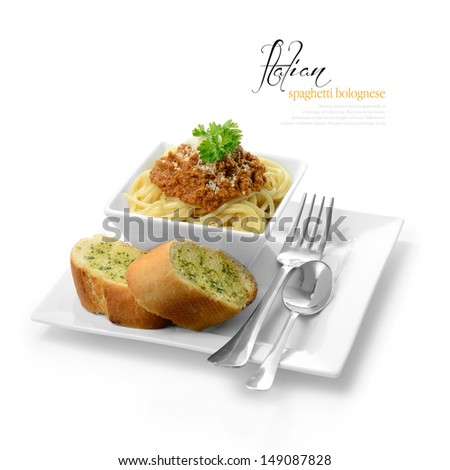 High key studio shot of freshly prepared Italian Spaghetti Bolognese with garlic bread. Selectively lit to create soft shadows. Copy space. - stock photo