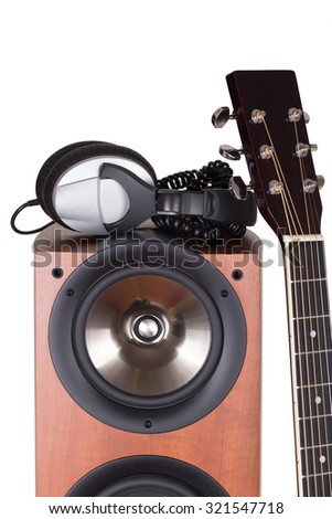 high loudspeaker tower with acoustic guitar over white background